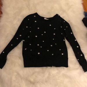 Women's black sweater with silver stars